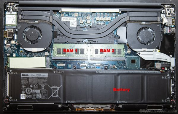 Laptop interior showing battery and RAM cards